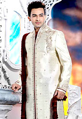 Today fashion is really about sensuality which can be seen in this creation. This off white elegant sherwani designed with cutdana, beads, stone and patch work. The beautiful heavy embroidery on front border, collar, back and cuffs made it awesome and gives you stylish and attractive look to others. Contrasting churidar is enhanced your personality. This sherwani made with jacquard fabric. Accessories shown in the image is just for photography purpose. Slight Color variations are possible due to differing screen and photograph resolutions.