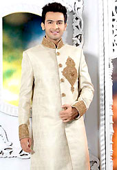 Emblem of fashion and style, each piece of our range of designer sherwani is certain to enhance your look as per todays trends. This cream elegant sherwani designed with zardoshi, zarkan, cutdana, stone and patch work. The beautiful heavy embroidery on front border, collar, back and cuffs made it awesome and gives you stylish and attractive look to others. Contrasting churidar is enhanced your personality. This sherwani made with jacquard fabric. Accessories shown in the image is just for photography purpose. Slight Color variations are possible due to differing screen and photograph resolutions.