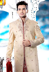 Its cool and have a very modern look to impress all. This cream elegant sherwani designed with all over beads, zardosi, stone and patch work. The beautiful heavy embroidery on front border, collar, back and cuffs made it awesome and gives you stylish and attractive look to others. Contrasting dhoti is enhanced your personality. This sherwani made with jacquard fabric. Accessories shown in the image is just for photography purpose. Slight Color variations are possible due to differing screen and photograph resolutions.
