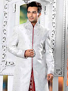 Today fashion is really about sensuality which can be seen in this creation. This light grey elegant sherwani designed with all over beads, zarkan, zardosi, stone and patch work. The beautiful heavy embroidery on front border, collar, back and cuffs made it awesome and gives you stylish and attractive look to others. Contrasting dhoti is enhanced your personality. This sherwani made with jacquard fabric. Accessories shown in the image is just for photography purpose. Slight Color variations are possible due to differing screen and photograph resolutions.