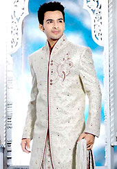 Make your collection more attractive with this dazzling sherwani. This off white elegant sherwani designed with all over beads, zarkan, zardosi, stone and patch work. The beautiful heavy embroidery on front border, collar, back and cuffs made it awesome and gives you stylish and attractive look to others. Contrasting dhoti is enhanced your personality. This sherwani made with jacquard fabric. Accessories shown in the image is just for photography purpose. Slight Color variations are possible due to differing screen and photograph resolutions.