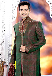 Its cool and have a very modern look to impress all. This deep green elegant sherwani designed with all over beads, zarkan, zardosi, stone and patch work. The beautiful heavy embroidery on front border, collar, back and cuffs made it awesome and gives you stylish and attractive look to others. Contrasting dhoti is enhanced your personality. This sherwani made with jacquard fabric. Accessories shown in the image is just for photography purpose. Slight Color variations are possible due to differing screen and photograph resolutions.