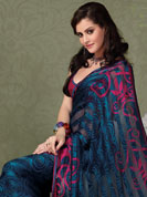The very silhouette and styling of this outfit proves quiet flattering for most body types and renders a rather grand and majestic appeal. This navy blue sattan patti saree is nicely designed with beautiful print work in spiral and floral pattern. Floral patterned border is nice and looking impressive with nice colorblend. Matching blouse is available with this saree. Slight color variations possible due to differing screen and photograph resolution.