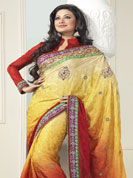 Be the rocker in the party by wearing this cool wear. This yellow and red saree is beautifully designed with extensive embroidered border and butti patch work. Embroidery is done with resham, zari and sequins work. This fabulous party wear saree is specially crafted for your stunning and gorgeous look. This beautiful drape is crafted with crepe fabric. Matching blouse come along with this saree. Slight color variations are possible due to differing screen and photograph resolution.