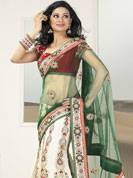 The fascinating beautiful subtly garment with lovely patterns. This green and white lehenga saree is beautifully designed with extensive embroidered border and butti patch work. Embroidery is done with resham, zari and sequins work. This fabulous party wear saree is specially crafted for your stunning and gorgeous look. This beautiful drape is crafted with net and georgette fabric. Matching blouse come along with this saree. Slight color variations are possible due to differing screen and photograph resolution.