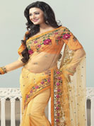 An occasion wear perfect is ready to rock you. This orange saree is beautifully designed with extensive embroidered border and butti patch work. Embroidery is done with resham, zari and sequins work. This fabulous party wear saree is specially crafted for your stunning and gorgeous look. This beautiful drape is crafted with net fabric. Matching blouse come along with this saree. Slight color variations are possible due to differing screen and photograph resolution.