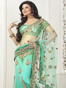 Envelope yourself in classic look with this charming saree. This light pastel green lehenga saree is beautifully designed with extensive embroidered border and butti patch work. Embroidery is done with resham, zari and sequins work. This fabulous party wear saree is specially crafted for your stunning and gorgeous look. This beautiful drape is crafted with net fabric. Matching blouse come along with this saree. Slight color variations are possible due to differing screen and photograph resolution.