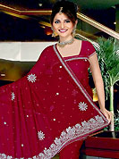 Emblem of fashion and beauty, each piece of our range of embroidered saree is certain to enhance your look as per today's trends. This beautiful saree have beautiful designed with stone, cutdana, nag, zarken work in form of floral motifs. This saree material is chiffon. Get an attractive look with this casual wear saree. Matching Blouse is available with this saree. Slight Color variations are possible due to differing screen and photograph resolutions.