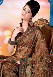 You can be sure that ethnic fashions selections of clothing are taken from the latest trend in today's fashion. This brown saree is nicely designed with embroidered patch. Embroidery is done with resham, zari and stone work in form of floral motifs. This saree gives you a modern and different look in fabulous style. This beautiful drape is crafted with glass tissue fabric. Matching blouse is available with this saree. Slight color variations are possible due to differing screen and photograph resolution.