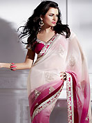 Take the fashion industry by storm in this beautiful embroidered saree. This White and Pink Faux Georgette Saree is nicely designed with embroidery work which is done with resham and sequins work in floral motifs. This stylish saree gives you an ethnic look and increasing your beauty. Matching Blouse is available. Slight Color variations are possible due to differing screen and photograph resolutions.