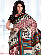 The evolution of style species collection spells pure femininity. This saree is nicely designed with zigzag, stripe and traditional art print work in fabulous style. This beautiful saree is used for casual porpose which gives you a singular and dissimilar look. Color blend of this saree is nice. This saree is made with art silk fabric. Matching blouse is available with this saree. Slight Color variations are possible due to differing screen and photograph resolutions.