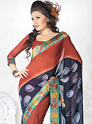 An endearing splash oh colors look gorgeous tridimensional charm. This deep rust and deep grey faux georgette saree is nicely designed with floral, geometric print and brocade patch work. The beautiful embroidery patch border on saree make attractive to impress all. Mixing of colors and patterns make different to others and gives a complete look. Matching blouse is available. Slight color variations are possible due to differing screen and photograph resolution.