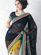 Take a look on the changing fashion of the season. This black, yellow and cream faux georgette saree is nicely designed with embroidered patch work. Embroidery is done with resham, sequins and zari work in form of floral motifs. The beautiful embroidery patch border on saree make attractive to impress all. Mixing of colors and patterns make different to others and gives a complete look. Matching blouse is available. Slight color variations are possible due to differing screen and photograph resolution.