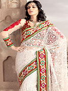 Era with extension in fashion, style, Grace and elegance have developed grand love affair with this ethnical wear. This off white saree have beautiful embroidery work which is embellished with resham and zari work in form of floral motifs. Beautiful broad embroidery patch border on saree make attractive to impress all. Fabulous designed embroidery gives you an ethnic look and increasing your beauty. This beautiful drape is crafted with net fabric. Matching blouse is available. Slight Color variations are possible due to differing screen and photograph resolutions.