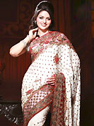 Breathtaking collection of sarees with stylish embroidery work and fabulous style. This saree is nicely designed with beautiful grave embroidered border and floral patch work done with resham, cutdana sequins and stone work. This drape material is jacquard fabric. Matching blouse is available. Slight color variations are possible due to differing screen and photograph resolution.