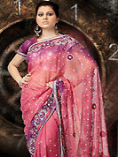 The traditional patterns used on this shimmer saree maintain the ethnic look. This pink saree make you trendy look. This Drape has a beautiful embroidered border and butti work on all over which is embellished with stone, sequins, resham and zarkan work. Floral butti on all over saree and border make different to others. Color blend of this saree is nice. Matching designer blouse. This drape is also available in pastel green, yellow and mauve color. Slight color variations are possible due to differing screen and photograph resolution.