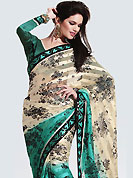 Get ready to sizzle all around you by sparkling saree. This saree is awesomely designed with satin patti with floral print work and embroidered border on all over which make symbol of elegance. Saree has nice color combination. Look stunning rich with dark shades and floral patterns. This season dazzle and shine in pure colors. It's cool and has a very modern look to impress all. This drape material is faux georgette. Matching blouse is available. Slight Color variations are possible due to differing screen and photograph resolutions.