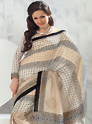 Elegance and innovation of designs crafted for you. This saree is nicely designed with floral and geometric art print work in fabulous style. This beautiful saree is used for festival and casual porpose which gives you a singular and dissimilar look. Color blend of this saree is nice. This saree is made with art silk fabric. Matching blouse is available with this saree. Slight Color variations are possible due to differing screen and photograph resolutions.