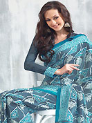 Style and trend will be at the peak of your beauty when you adorn this saree. This saree is nicely designed with floral, leaf and geometric art print work in fabulous style. This beautiful saree is used for festival and casual porpose which gives you a singular and dissimilar look. Color blend of this saree is nice. This saree is made with art silk fabric. Matching blouse is available with this saree. Slight Color variations are possible due to differing screen and photograph resolutions.