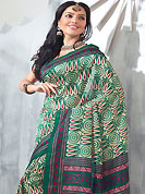 Let your personality articulate for you with this amazing printed saree. This saree is nicely designed with floral, paisley, spiral, stripe and geometric art print work in fabulous style. This beautiful saree is used for festival and casual porpose which gives you a singular and dissimilar look. Color blend of this saree is nice. This saree is made with art silk fabric. Matching blouse is available with this saree. Slight Color variations are possible due to differing screen and photograph resolutions.