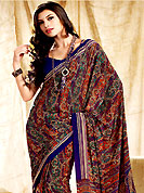 Make a trendy look with this classic printed saree. This saree is nicely designed with floral and paisley print work in fabulous style. This beautiful saree is used for casual porpose which gives you a singular and dissimilar look. Color blend of this saree is nice. This saree is made with faux crepe fabric. Matching blouse is available with this saree. Slight Color variations are possible due to differing screen and photograph resolutions.