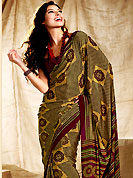 Welcome to the new era of Indian fashion wear. This saree is nicely designed with floral and check print work in fabulous style. This beautiful saree is used for casual porpose which gives you a singular and dissimilar look. Color blend of this saree is nice. This saree is made with faux crepe fabric. Matching blouse is available with this saree. Slight Color variations are possible due to differing screen and photograph resolutions.