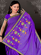 Ultimate collection of embroidery sarees with fabulous style. This purple saree have beautiful embroidery work which is embellished with resham and zari work in form of floral motifs. Beautiful embroidery patch work border on saree make attractive to impress all. This beautiful drape is crafted with georgette fabric. Matching blouse is available. This saree is also available in red, green, pink, peach, aqua, orange, voilet colors. Slight Color variations are possible due to differing screen and photograph resolutions.