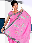 Be the cynosure of all eyes with this wonderful casual wear in flattering colors and combinations. This purple saree have beautiful embroidery work which is embellished with resham and sequins work in form of floral and paisley motifs. Beautiful embroidery patch work border on saree make attractive to impress all. This beautiful drape is crafted with georgette fabric. Matching blouse is available. This saree is also available in red, green, pink, peach, aqua, orange, voilet colors. Slight Color variations are possible due to differing screen and photograph resolutions.