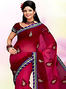 Take a look on the changing fashion of the season. This saree is beautifully designed with extensive embroidered work. Embroidery is done with self zari weaving and gota patti work in form of paisley motifs. Contrast border on saree make attractive to impress all. This fabulous party wear saree is specially crafted for your stunning and gorgeous look. This beautiful drape is crafted with faux georgette fabric. Matching Blouse is available with this saree. Slight Color variations are possible due to differing screen and photograph resolutions.