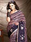 Ultimate collection of embroidery sarees with fabulous style. This saree is nicely designed with floral, stripe print and embroidered patch work. Embroidery is done with resham and sequins work in form of floral motifs. Beautiful combinations of print and embroidered patch work on saree make attractive to impress all. This saree gives you a modern and different look in fabulous style. Matching blouse is available with this saree. This saree is also available in Golden Yellow and Navy Blue, Light Purple and Navy Blue, Olive Green and Navy Blue colors. Slight color variations are possible due to differing screen and photograph resolution.