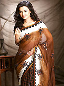 The popularity of this dress comes from the fact that it showcases the beauty modesty as well as exquisitely. This saree is nicely designed with dot print and embroidered patch work. Embroidery is done with resham and zari work in form of floral motifs. Beautiful combinations of print and embroidered patch work on saree make attractive to impress all. This saree gives you a modern and different look in fabulous style. Matching blouse is available with this saree. This saree is also available in Turquoise Blue and White, Olive Green and White, Brown and White colors. Slight color variations are possible due to differing screen and photograph resolution.