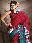 Outfit is a novel ways of getting yourself noticed. This saree is nicely designed with floral print and embroidered patch work. Embroidery is done with resham work in form of floral motifs. Beautiful combinations of print and embroidered patch work on saree make attractive to impress all. This saree gives you a modern and different look in fabulous style. Matching blouse is available with this saree. This saree is also available in A Green, Beige and Red B Red, Beige and Purple C Yellow, Beige and Pink colors. Slight color variations are possible due to differing screen and photograph resolution.