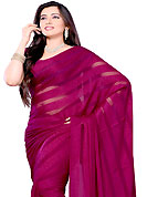 It is color this season and bright shaded suits are really something that is totally in vogue. This saree is beautifully designed with self weaving work. This fabulous party wear saree is specially crafted for your stunning and gorgeous look. This beautiful drape is crafted with georgette fabric. Matching Blouse is available with this saree. Slight Color variations are possible due to differing screen and photograph resolutions.