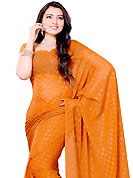 Try out this year top trend, glowing, bold and natural collection. This saree is beautifully designed with self weaving work in form of floral motifs. This fabulous party wear saree is specially crafted for your stunning and gorgeous look. This beautiful drape is crafted with georgette fabric. Matching Blouse is available with this saree. Slight Color variations are possible due to differing screen and photograph resolutions.