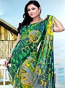 Take the fashion industry by storm in this beautiful printed saree. This saree is nicely designed with floral print work in fabulous style. This beautiful saree is used for festival and casual porpose which gives you a singular and dissimilar look. This saree is made with faux georgette fabric. Matching blouse is available with this saree. Slight Color variations are possible due to differing screen and photograph resolutions.