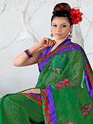Exquisite combination of color, fabric can be seen here. This green net saree is nicely designed with embroidered patch work in fabulous style. Embroidery is done with resham work in form of floral and paisley motifs. Beautiful embroidery work on saree make attractive to impress all. Matching blouse is available with this saree. Slight color variations are possible due to differing screen and photograph resolution.