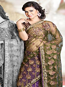 The evolution of style species collection spells pure femininity. This olive green and purple net lehenga style saree is nicely designed with embroidered and patch work in fabulous style. Embroidery is done with resham, zari, sequins, stone, cutdana, kasab and cut moti work in form of floral motifs. Beautiful embroidery work on saree make attractive to impress all. This saree gives you a modern and different look in fabulous style. Matching blouse is available with this saree. Slight color variations are possible due to differing screen and photograph resolution.
