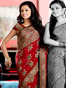 Breathtaking collection of sarees with stylish embroidery work and fabulous style. This maroon crepe saree is nicely designed with embroidered and silk patch work in fabulous style. Embroidery is done with resham, zari, sequins, stone and cutdana work in form of floral motifs. Beautiful embroidery work on saree make attractive to impress all. This saree gives you a modern and different look in fabulous style. Matching blouse is available with this saree. Slight color variations are possible due to differing screen and photograph resolution.
