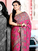 Breathtaking collection of sarees with stylish embroidery work and fabulous style. This dark pink crepe saree is nicely designed with embroidered and silk patch work in fabulous style. Embroidery is done with resham, zari, sequins, stone and cutdana work in form of floral motifs. Beautiful embroidery work on saree make attractive to impress all. This saree gives you a modern and different look in fabulous style. Matching blouse is available with this saree. Slight color variations are possible due to differing screen and photograph resolution.