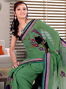Get ready to sizzle all around you by sparkling saree. This green georgette saree is nicely designed with embroidered and patch work in fabulous style. Embroidery is done with resham, zari, stone and cutdana work in form of floral motifs. Beautiful embroidery work on saree make attractive to impress all. Matching blouse is available with this saree. Slight color variations are possible due to differing screen and photograph resolution.