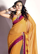 Make a trendy look with this classic printed saree. This mustard and deep magenta faux georgette saree is simply designed with zigzag, floral, stripe print and patch work. This beautiful saree is used for casual porpose which gives you a singular and dissimilar look. Color blend of this saree is nice. Matching blouse is available with this saree. Slight color variations possible due to differing screen and photograph resolution.
