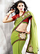 Different colors are a perfect blend of traditional Indian heritage and contemporary artwork. This green net saree have beautiful embroidery and patch work which is embellished with resham, zari, sequins, beads and stone work in floral motifs. Fabulous designed embroidery gives you an ethnic look and increasing your beauty. Contrasting red brocade blouse is available. Slight Color variations are possible due to differing screen and photograph resolutions.