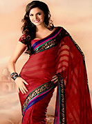 You can be sure that ethnic fashions selections of clothing are taken from the latest trend in today's fashion. This maroon faux georgette saree is simply designed with floral and paisley print work in fabulous style. This beautiful saree is used for casual porpose which gives you a singular and dissimilar look. Color blend of this saree is nice. Matching blouse is available with this saree. Slight color variations possible due to differing screen and photograph resolution.