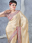 Different colors are a perfect blend of traditional Indian heritage and contemporary artwork. This light fawn dupion silk saree have beautiful embroidery patch work which is embellished with resham and stone work. Fabulous designed embroidery gives you an ethnic look and increasing your beauty. Contrasting red blouse is available. Slight Color variations are possible due to differing screen and photograph resolutions.