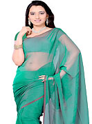 Look stunning rich with dark shades and floral patterns. Green tissue plain saree. This saree gives you a modern and different look in fabulous style. Matching blouse is available. Slight Color variations are possible due to differing screen and photograph resolutions.