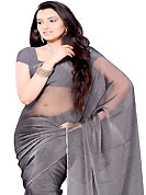 Elegance and innovation of designs crafted for you. Deep grey tissue shimmer saree. This saree gives you a modern and different look in fabulous style. Matching blouse is available. Slight Color variations are possible due to differing screen and photograph resolutions.