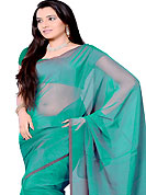 The evolution of style species collection spells pure femininity. Sea Green tissue saree. This saree gives you a modern and different look in fabulous style. Matching blouse is available. Slight Color variations are possible due to differing screen and photograph resolutions.