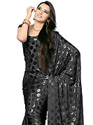 The evolution of style species collection spells pure femininity. This black georgette saree which is embellished with self weaving work. This saree gives you a modern and different look in fabulous style. Matching blouse is available. Slight Color variations are possible due to differing screen and photograph resolutions.