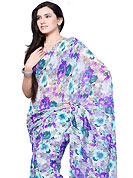Look stunning rich with dark shades and floral patterns. This off white and purple chiffon saree which is embellished with floral print work. This saree gives you a modern and different look in fabulous style. Matching blouse is available. Slight Color variations are possible due to differing screen and photograph resolutions.