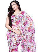 Style and trend will be at the peak of your beauty when you adorn this saree. This off white and pink chiffon saree which is embellished with floral print work. This saree gives you a modern and different look in fabulous style. Matching blouse is available. Slight Color variations are possible due to differing screen and photograph resolutions.